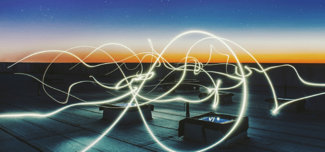 graphic with multiple intersecting and winding lines of light to symbolize complexity of data management