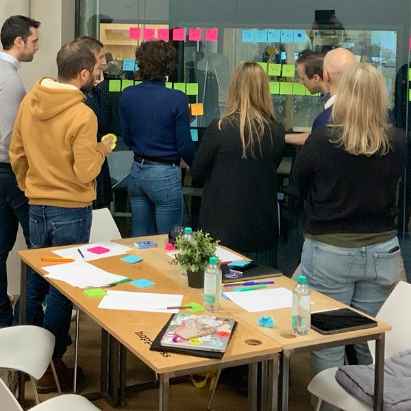 group of people around post-it during a workshop